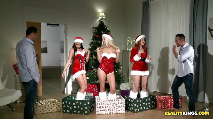 Two guys get the best Christmas surprise with redheaded Amarna Miller and her two hot friends Tricia Teen and Blanche Bradburry